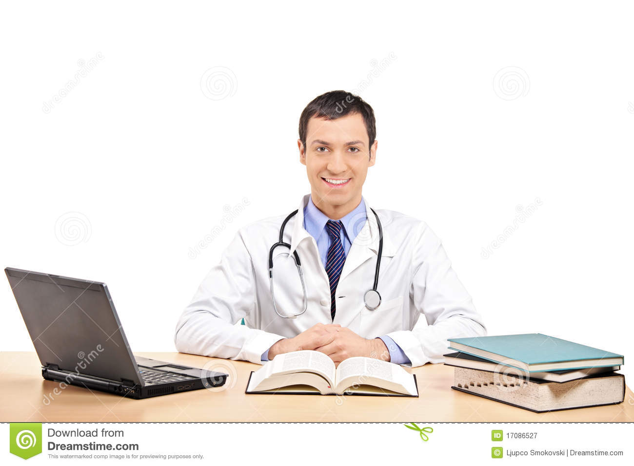A doctor posing in his office