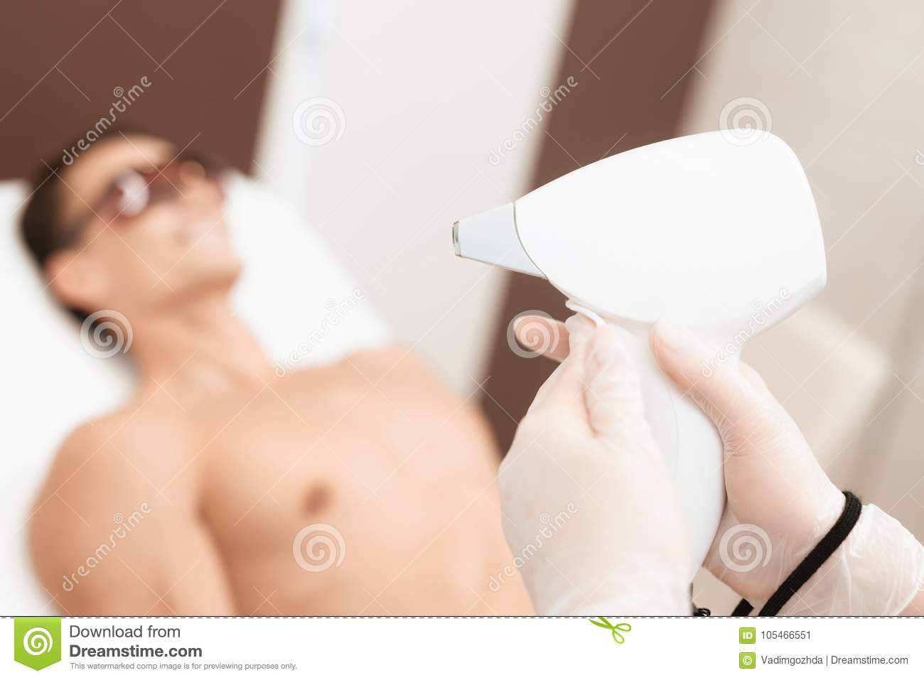 The Doctor Is Preparing A Laser Hair Removal Machine Against The