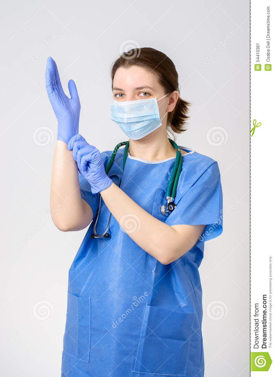 Doctor Putting On Blue Surgical Gloves Stock Image - Image of face ...