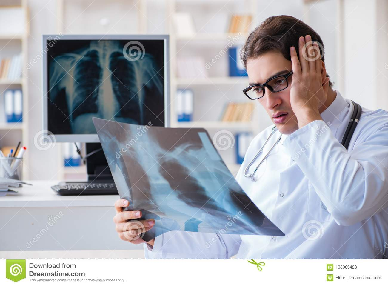The Doctor Radiologist Looking At X Ray Images Stock Photo Image