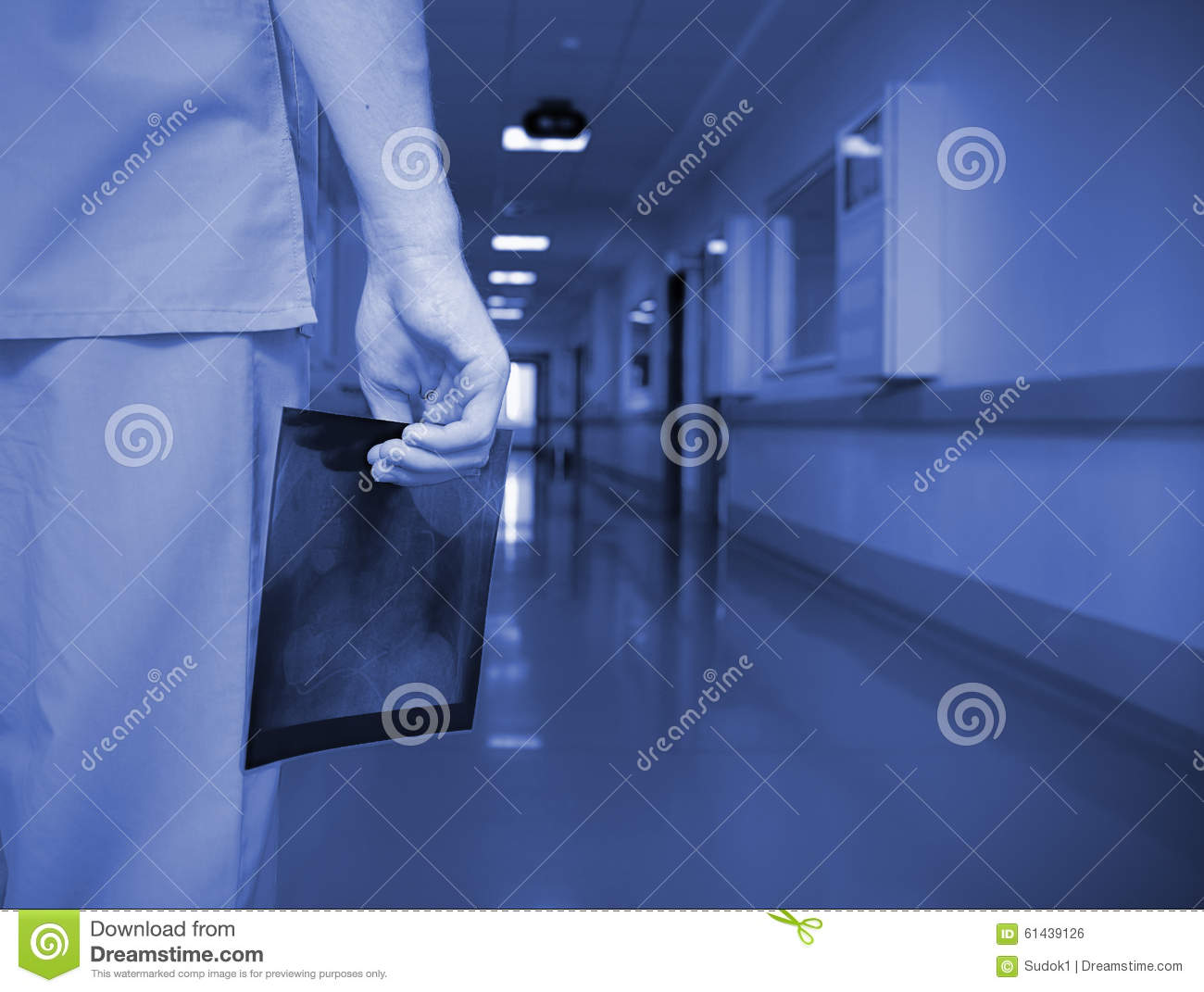 Doctor with x-ray image in the empty hallway