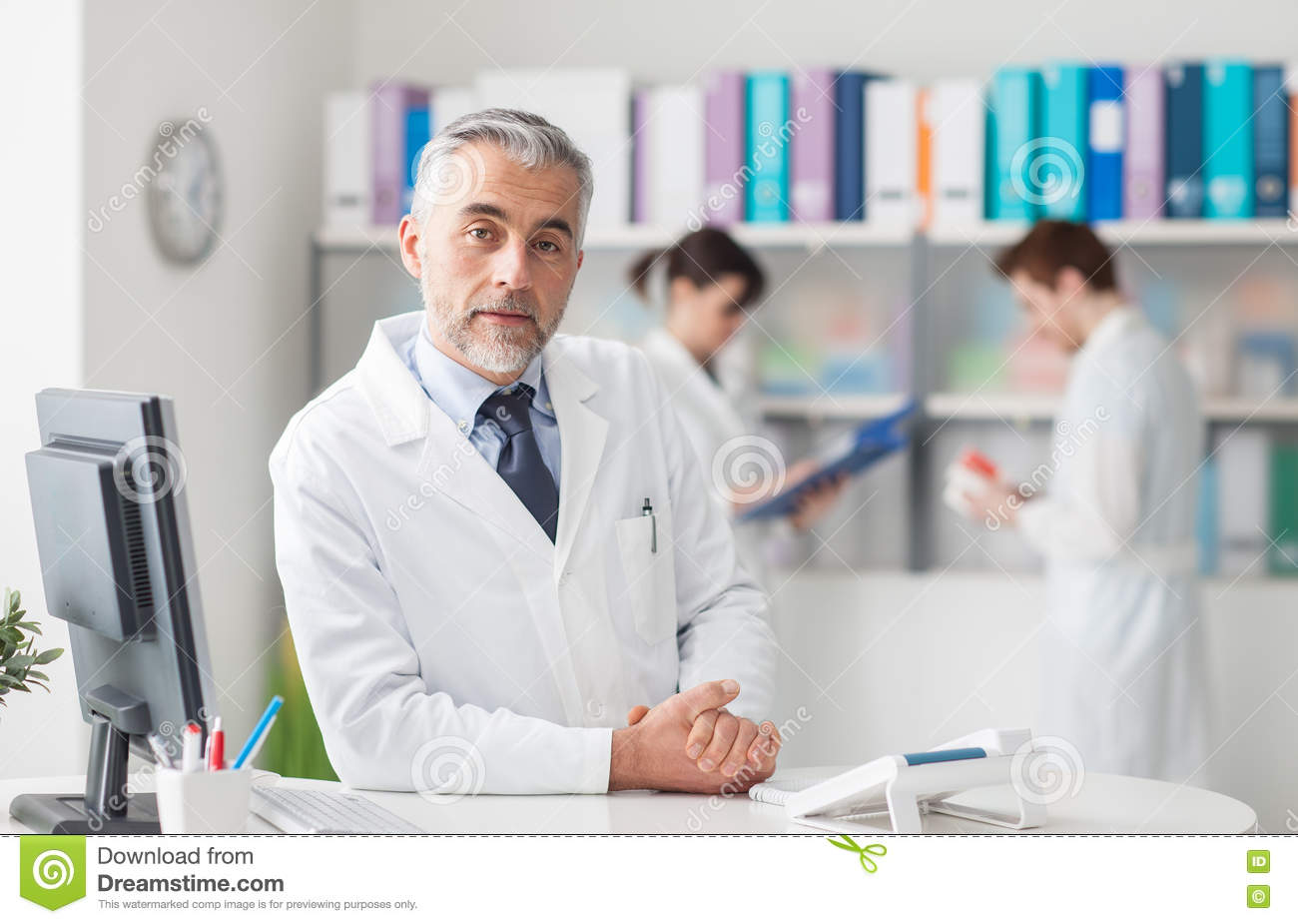 Doctor at the reception desk
