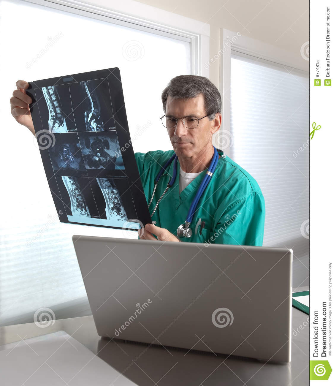 Doctor Reviewing Patient MRI Scans