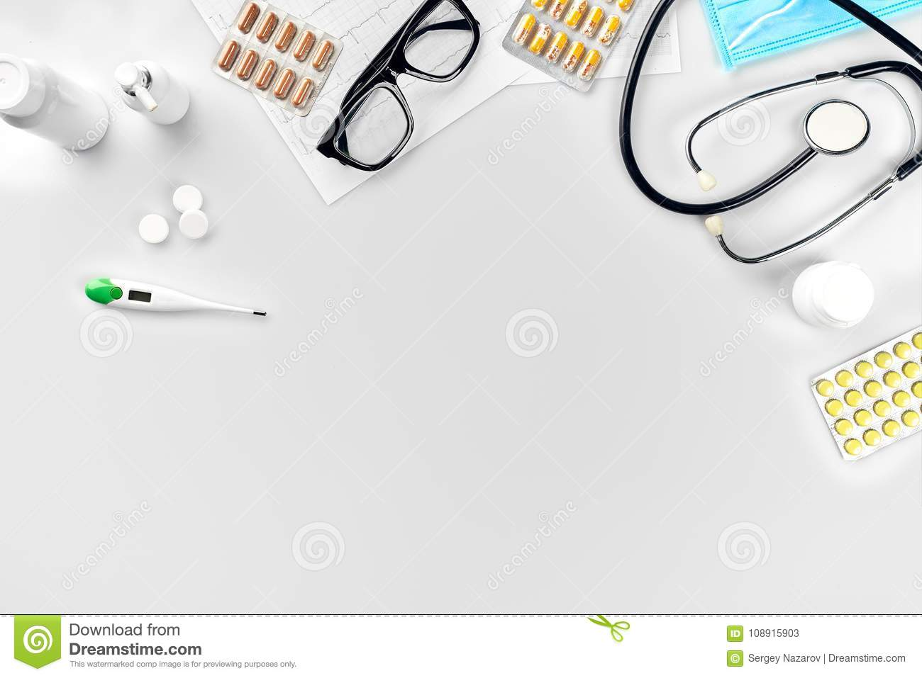 Doctor`s office desk with medical documents, charts, eyeglasses and stethoscope. Top view. Copy space