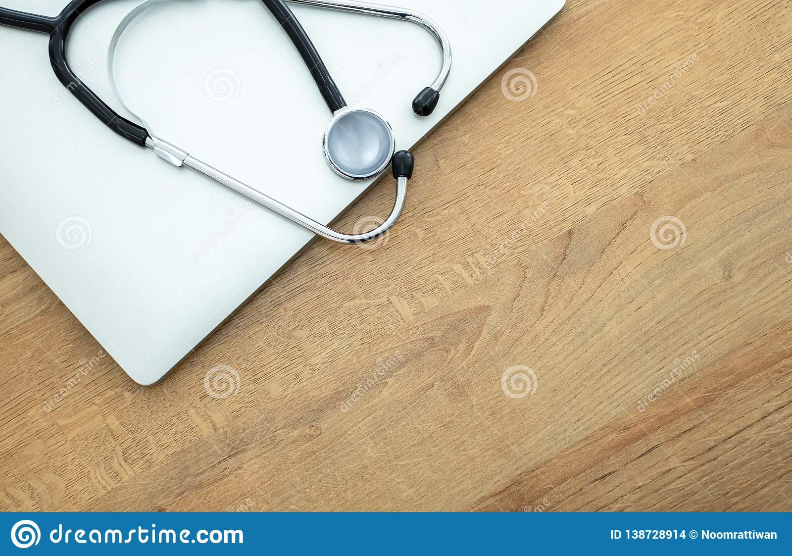 Doctor`s stethoscope and laptop computer