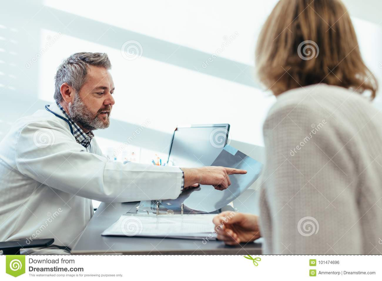Doctor Showing X Ray To Patient In Medical Office Stock Photo Image Of Doctor Dialog 101474696