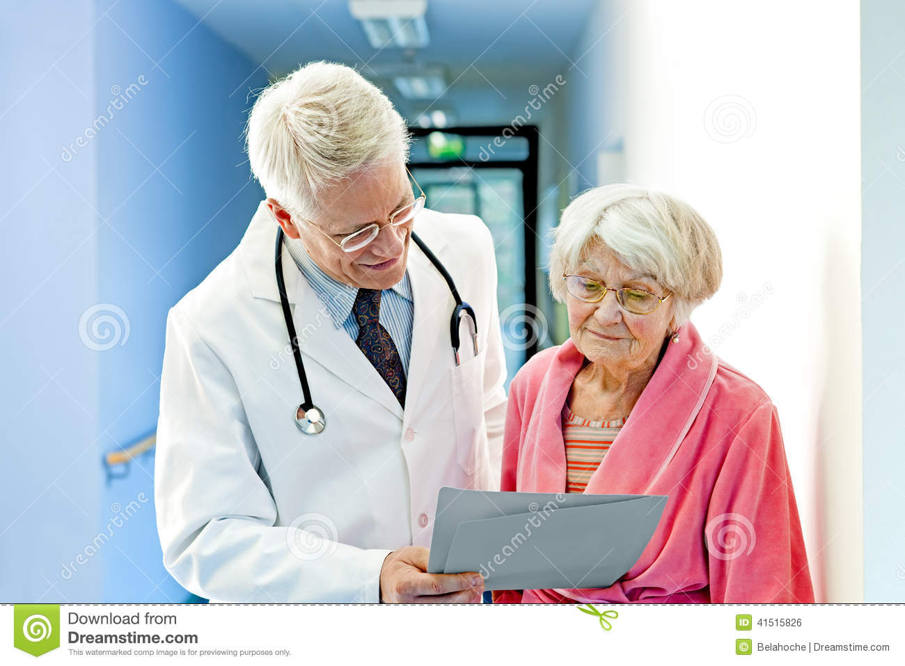 Doctor Shows Female Elderly Patient Results.