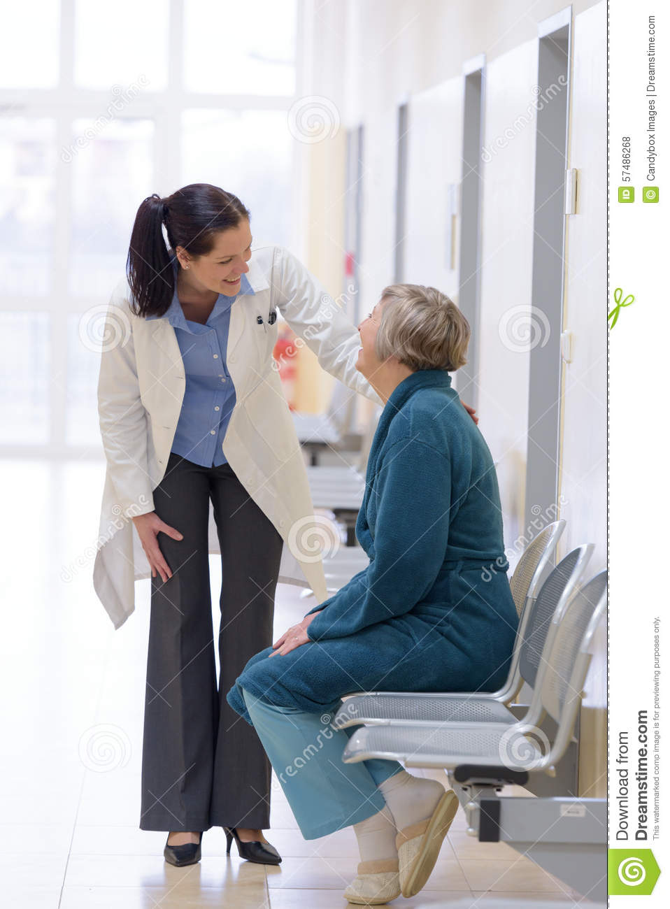 Doctor smiling with senior patient