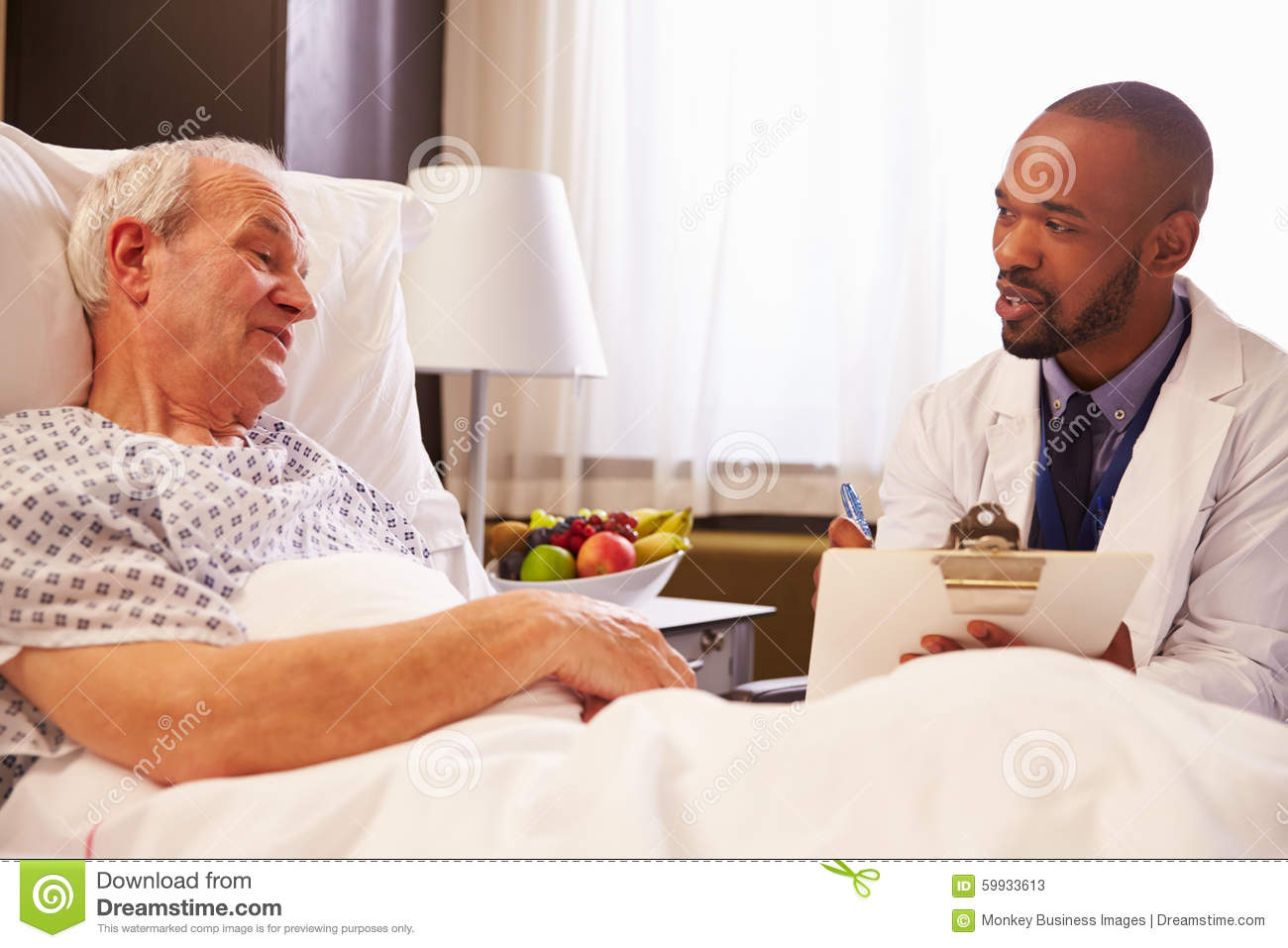 Doctor Talking To Senior Male Patient In Hospital Bed ...