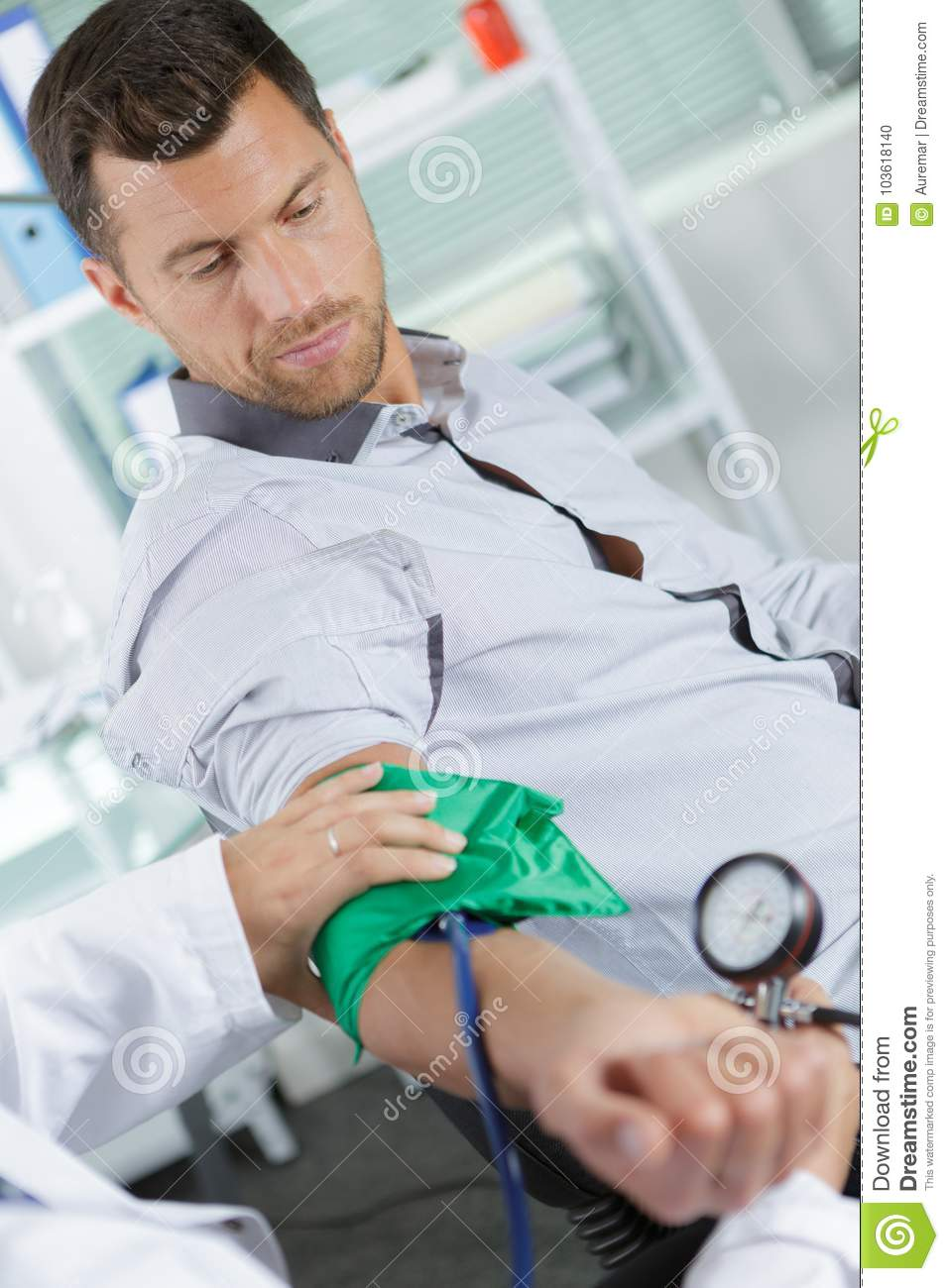 Doctor using sphygmomanometer to check blood pressure