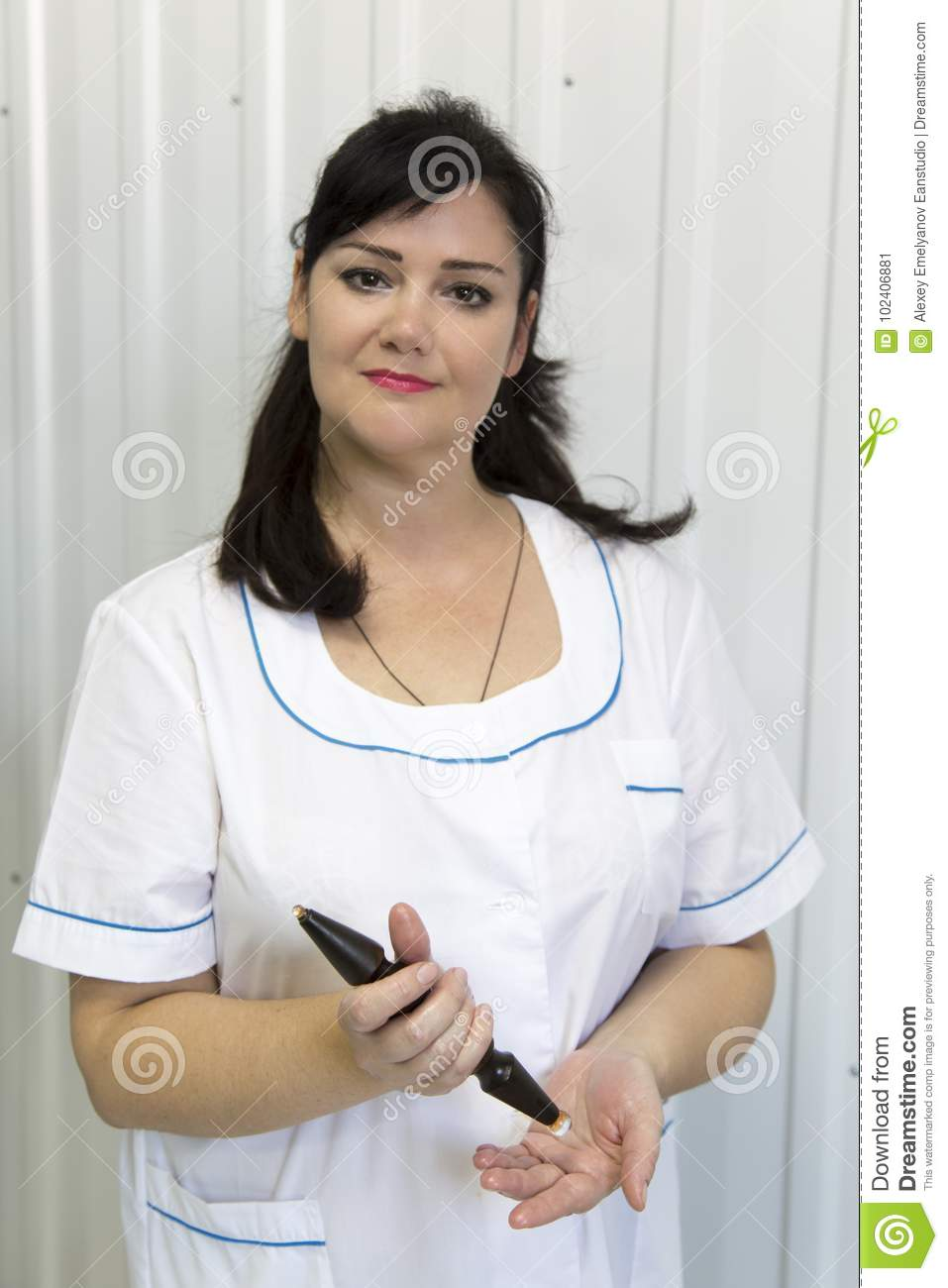 Doctor with a wand for massage