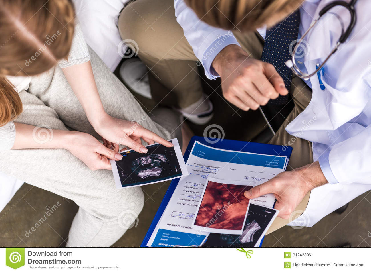 Doctor and woman looking at ultrasound scans