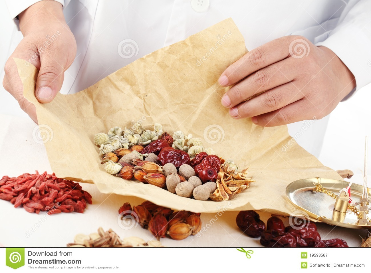 Chinese herbal treatment - Royalty Free Stock Photo Download Doctor Wrapping Chinese Herbal Medicine
