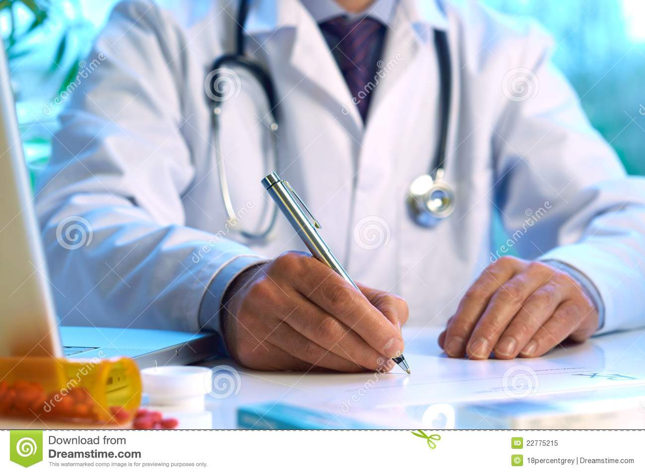 Male Doctor Writing On Medical Document Royalty Free Stock