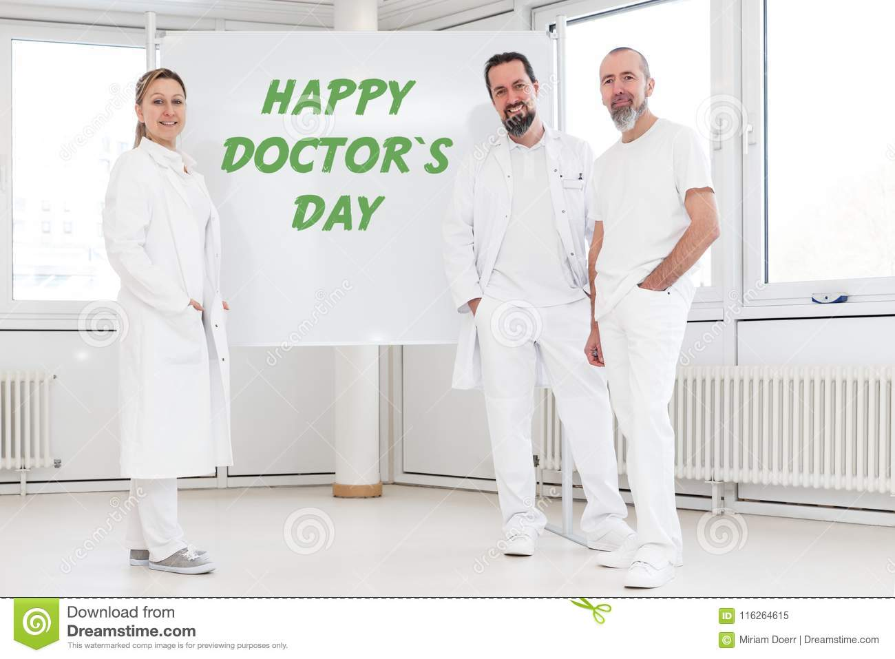 Doctors in front of a whiteboard with the text happy doctor`s da