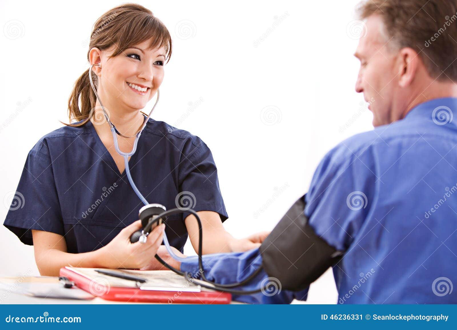 Doctors: Nurse Taking Blood Pressure Stock Image - Image ...