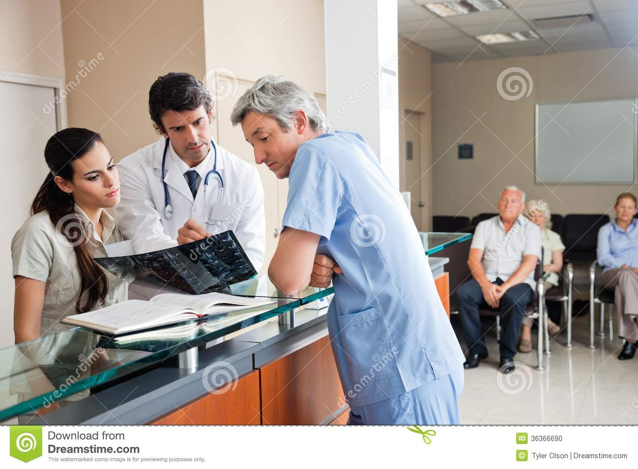 Doctors Reviewing X Ray At Reception Stock Photo Image