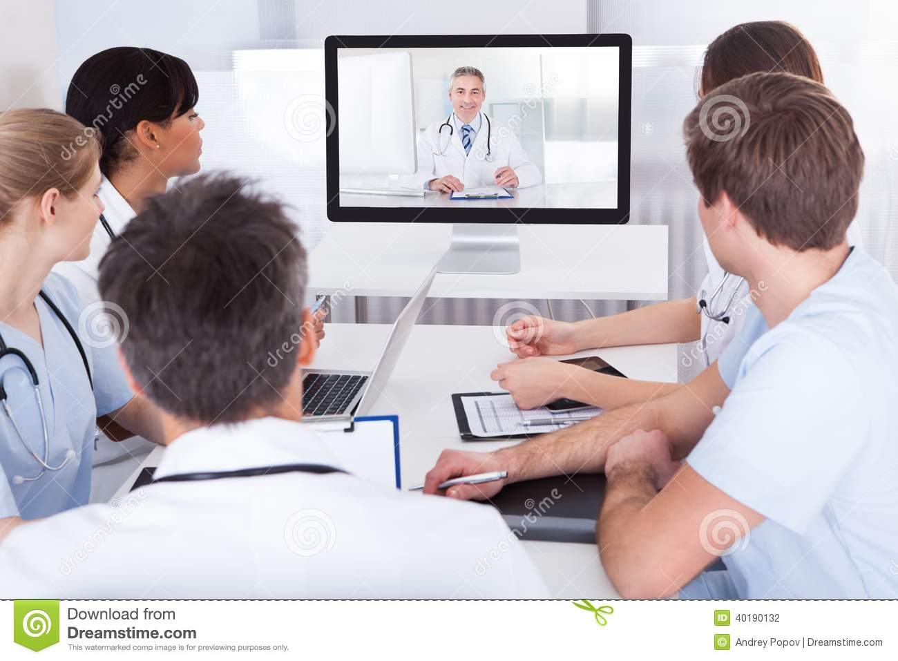 doctors watching online presentation stock photo image of monitor
