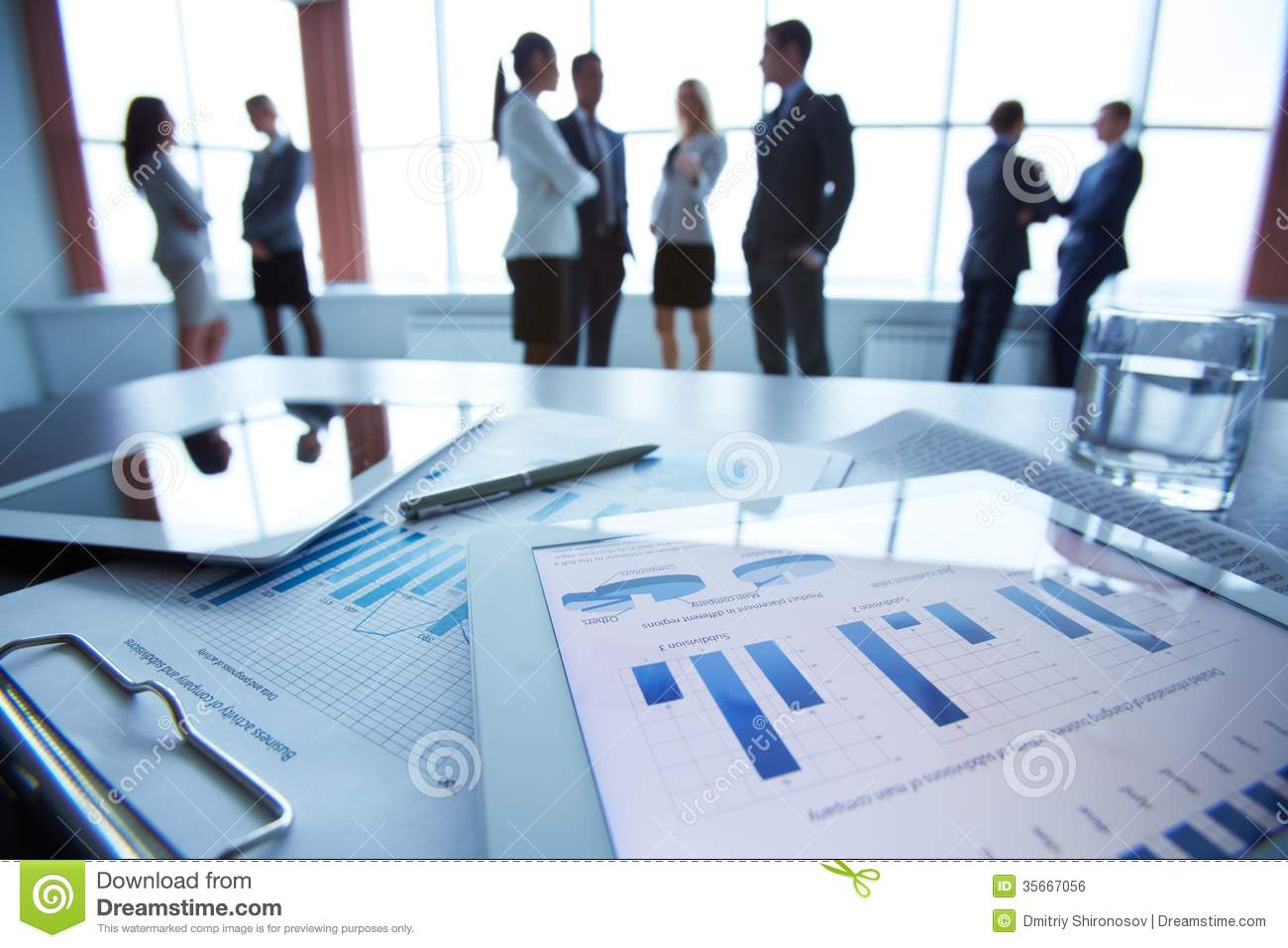 Business Document In Touchpad Lying On The Desk, Office Workers ...