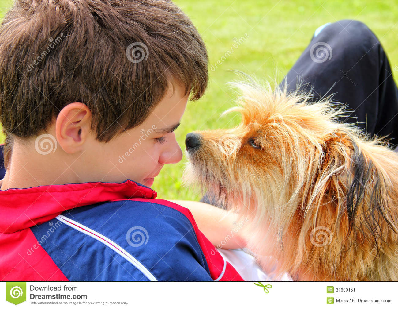 Dog sniffing the boys face