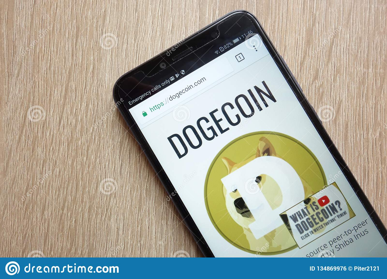 Dogecoin DOGE Cryptocurrency Website Displayed On Huawei Y6 2018