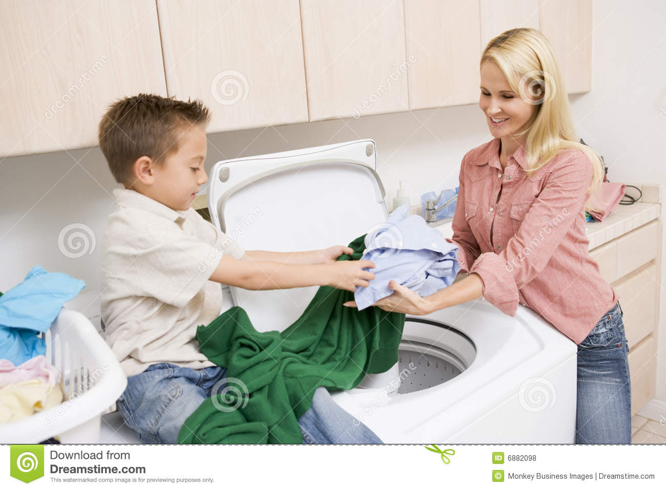 Doing laundry mother son