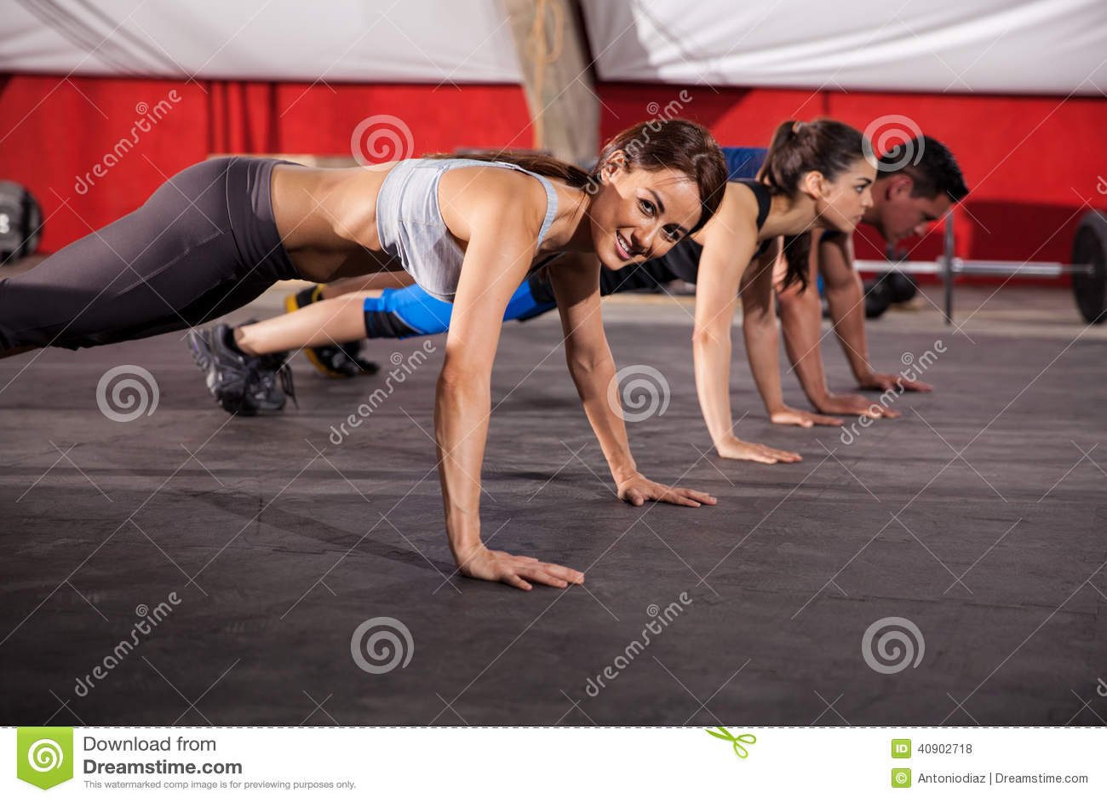Doing push ups at a gym