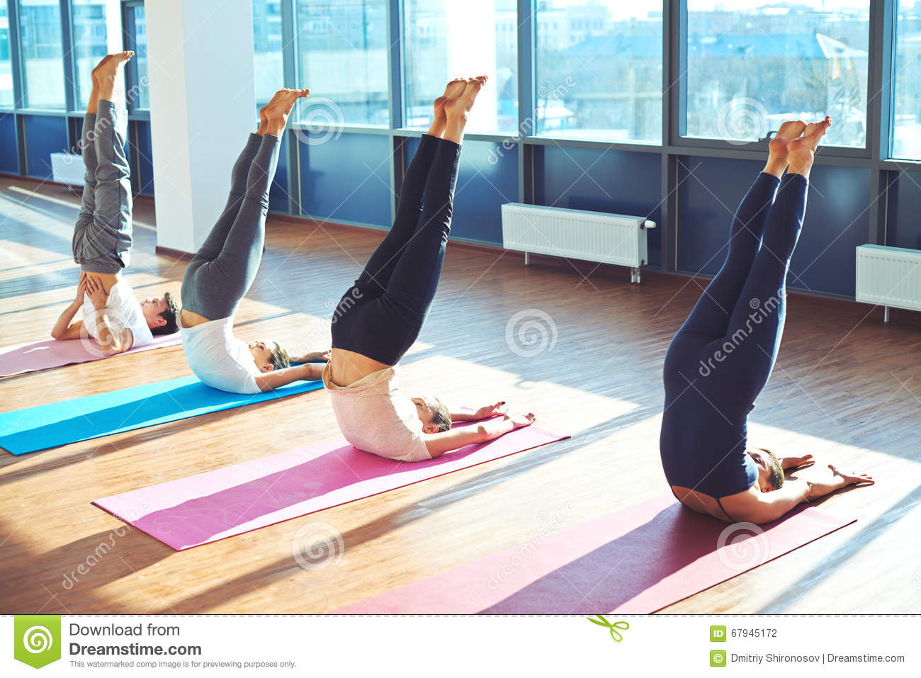 Doing yoga exercises stock photo image 67945172 for Floor yoga stretches