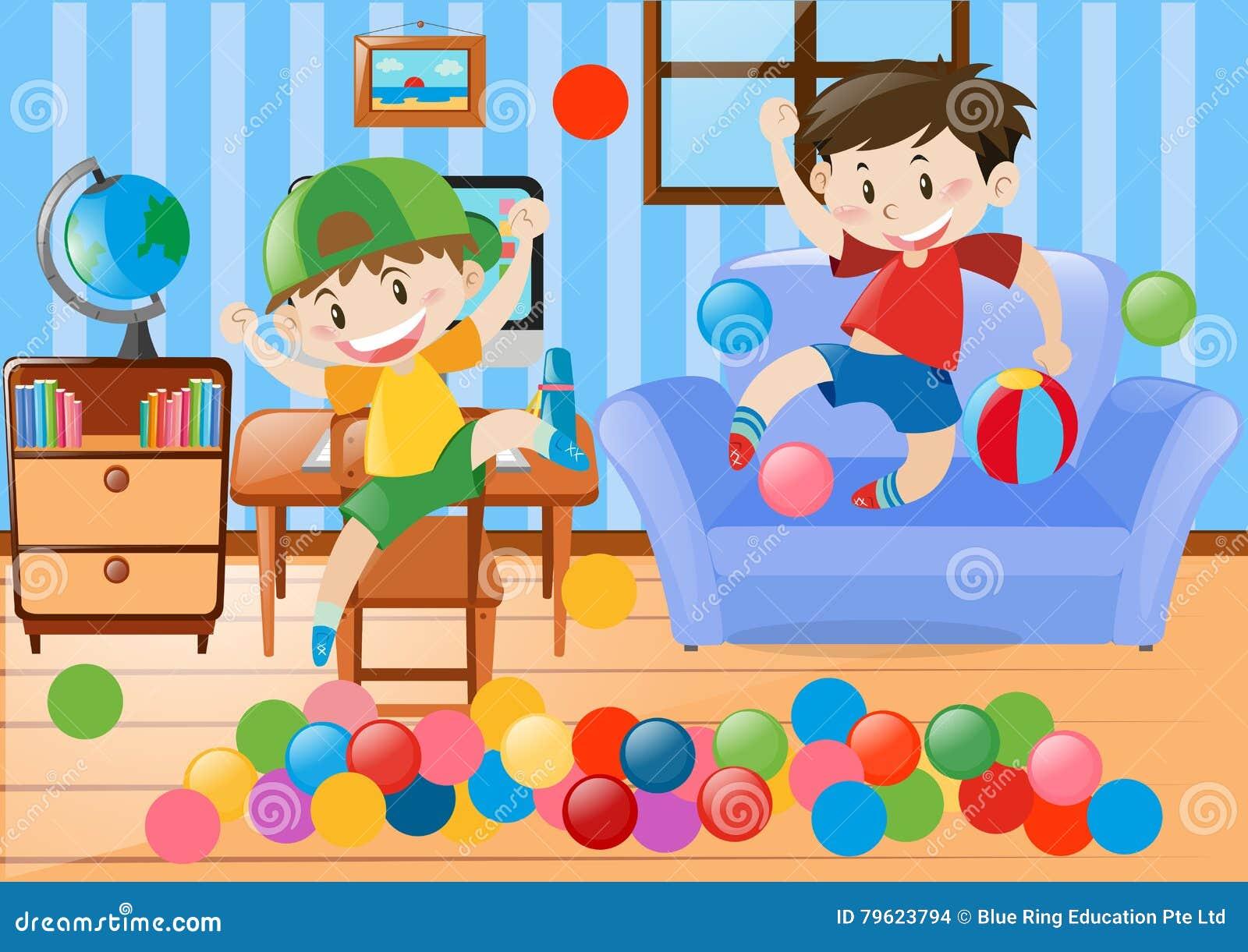Dois meninos que jogam a bola na sala