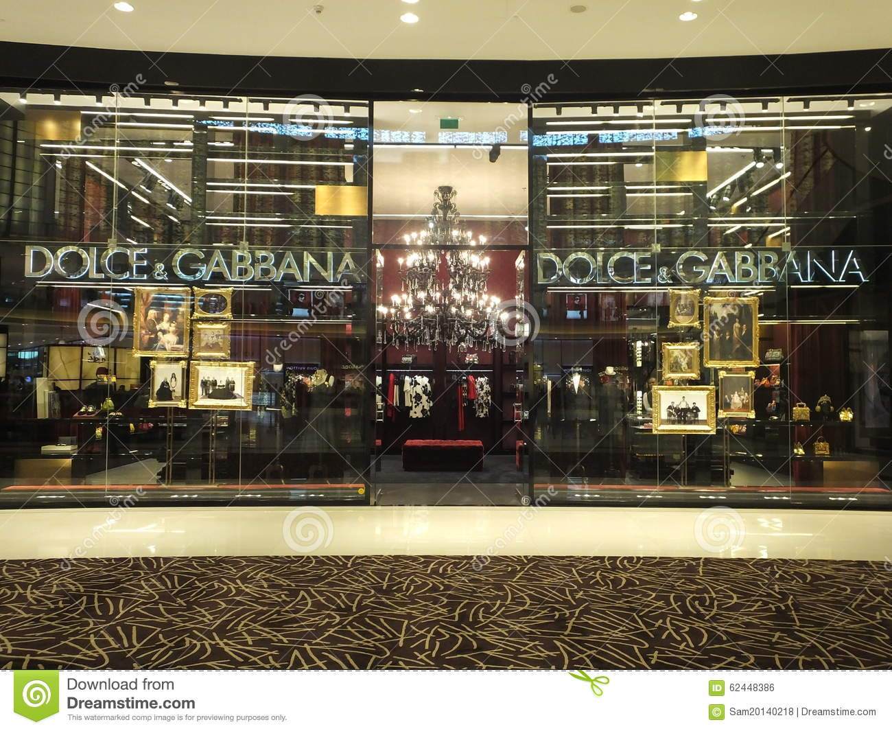 c696c2348dec Dolce & Gabbana fashion boutique display window with mannequin in luxury  clothes and accessories. Founded in 1985 by Italian designers Domenico Dolce  and ...