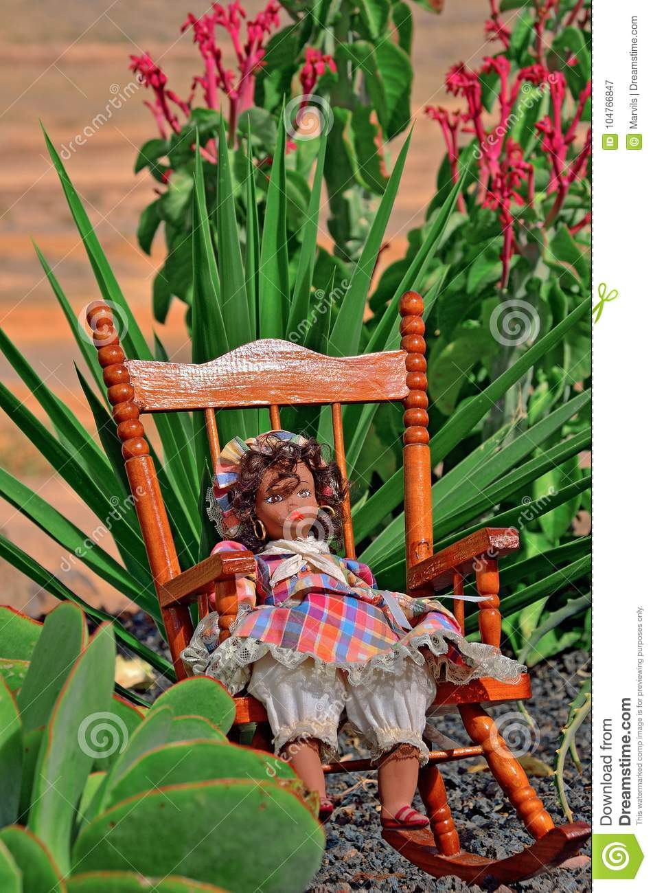 doll in dress relax in the chait at the garden near plant and flower - The Doll In The Garden