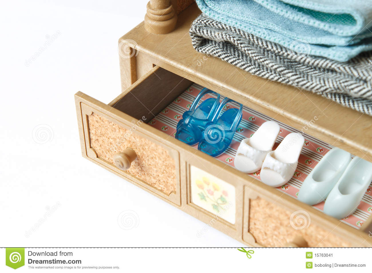 collection of doll shoes in a drawer. Focus on the blue shoes