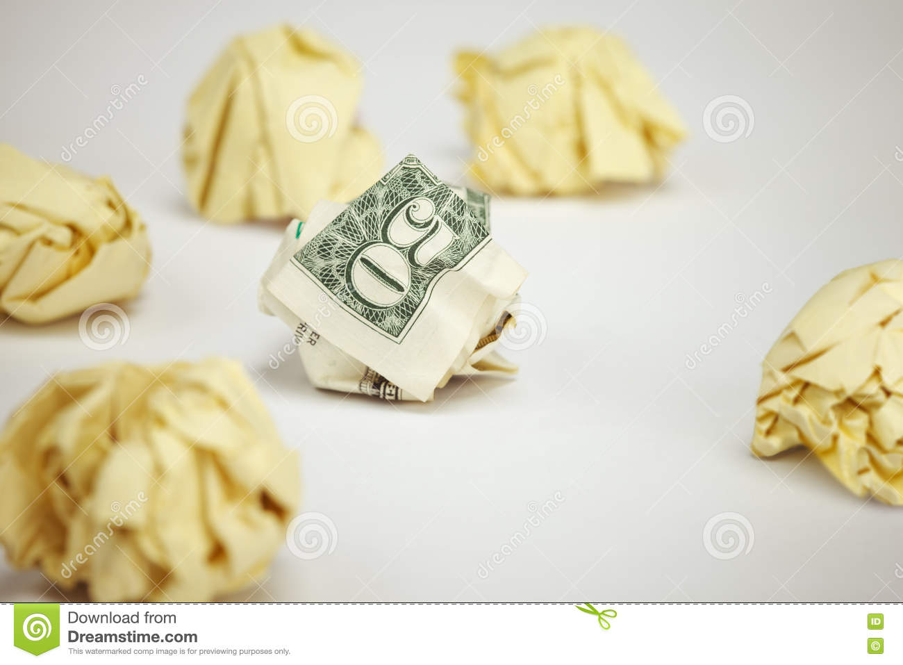 50 dollar bill among crumpled pieces of paper