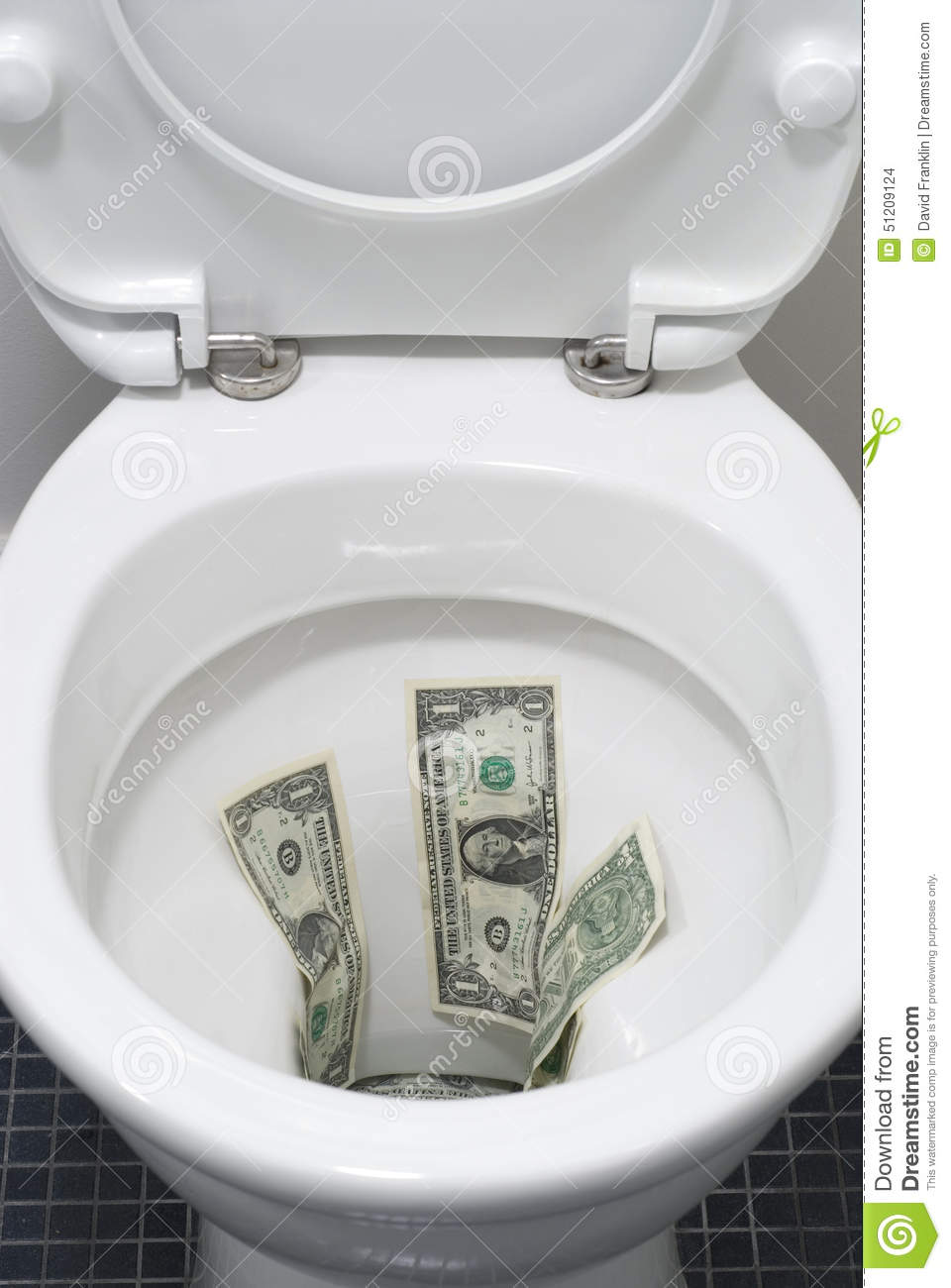 US One Dollar Bills Flushed Down A Toilet, Wasting Money Concept ...