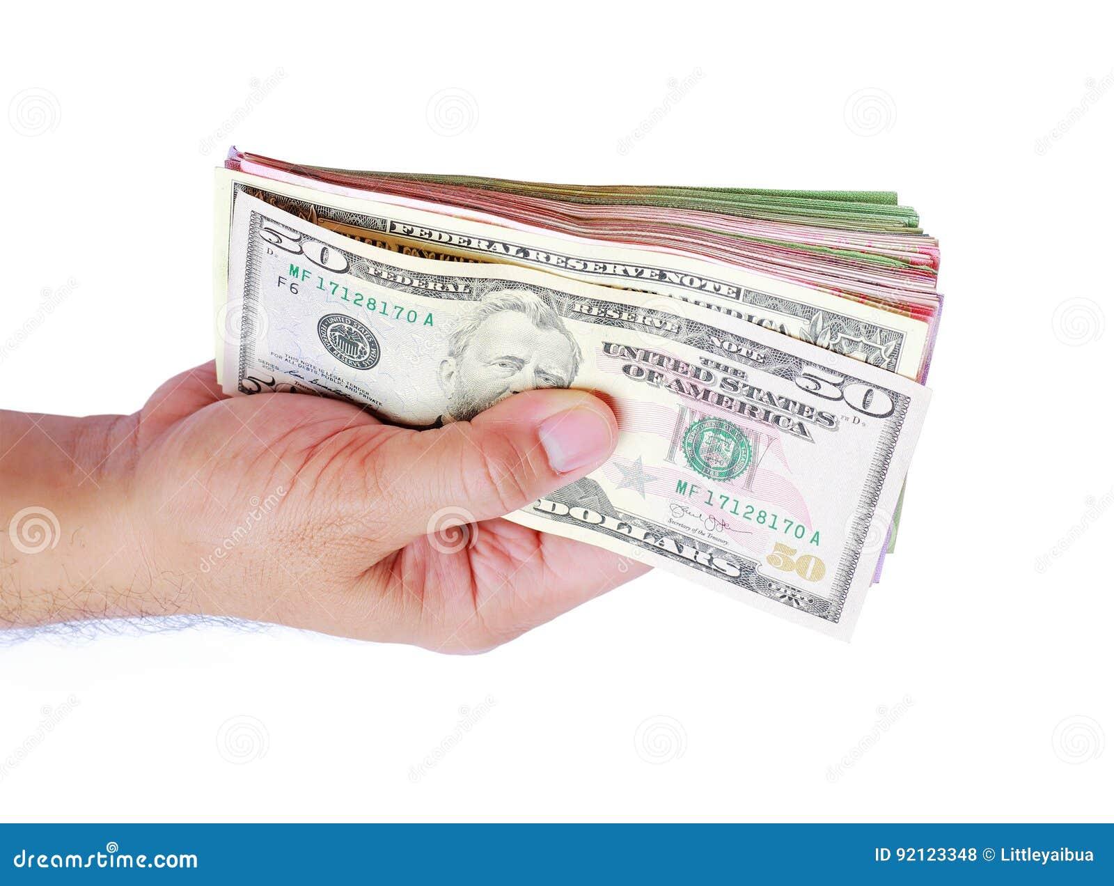 Dollar money showing in men`s hand on white background.