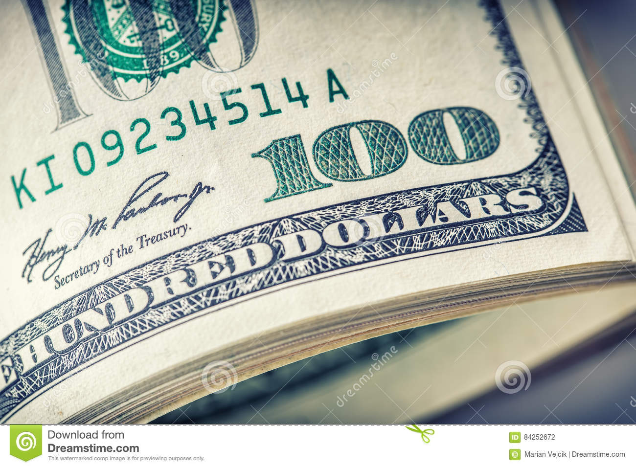 Dollars rolled closeup. American Dollars Cash Money. One Hundred Dollar Banknotes