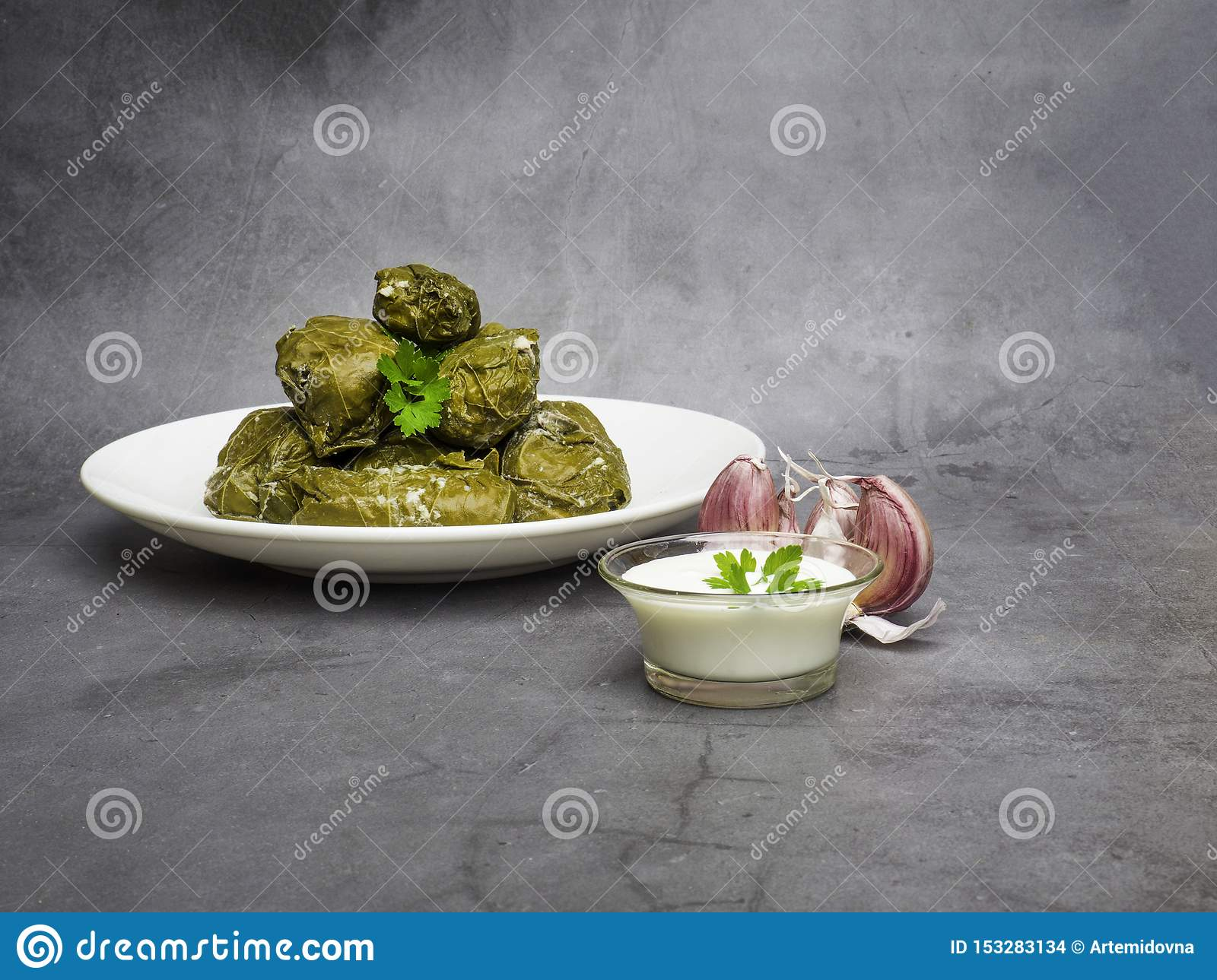 Dolma tolma, sarma - stuffed grape leaves with rice and meat. Traditional Caucasian, Ottoman, Turkish and Greek cuisine
