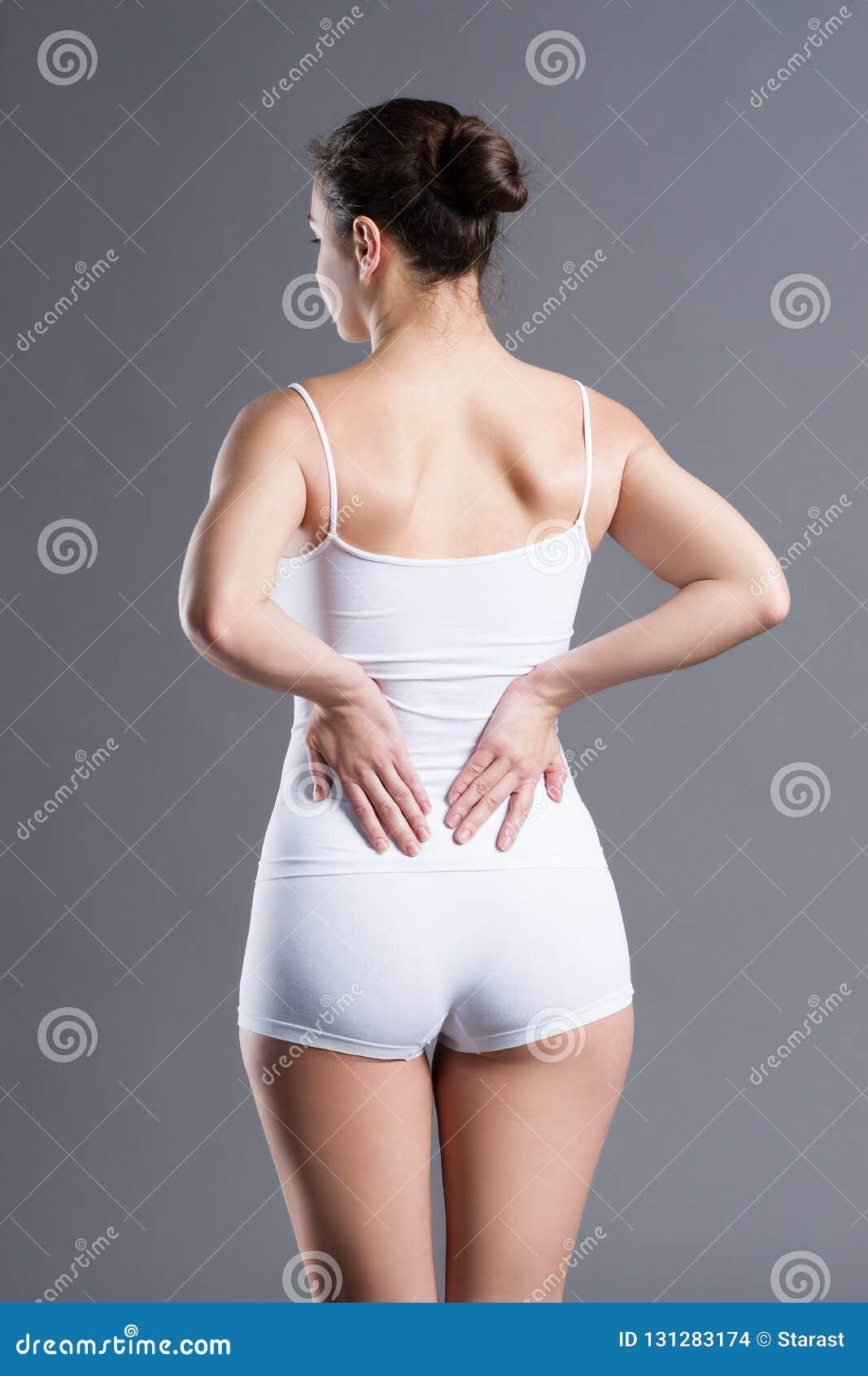 Dolor de espalda, inflamación del riñón, dolor en cuerpo del ` s de la mujer