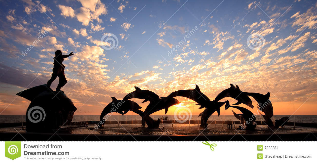 Dolphin Statue In Front Of Sunset Stock Images Image