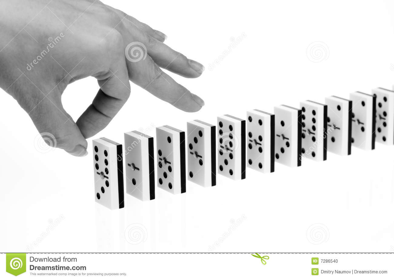Hand ready to start domino chain reaction  black amp white shot Domino Chain Reaction