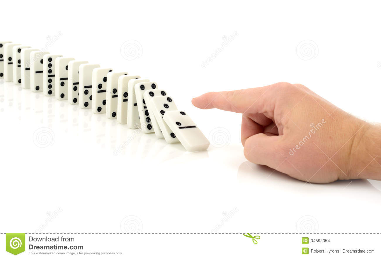 chain reaction of events  finger pushing a domino isolated on a whiteDomino Chain Reaction