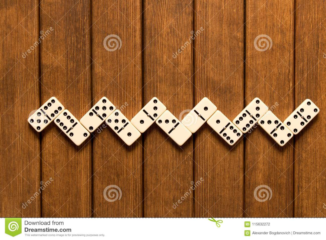 Domino game on wooden background . Top view . Empty space for te