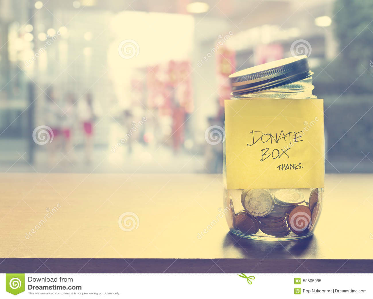 Donation box, coin in the glass bottle, vintage color tone