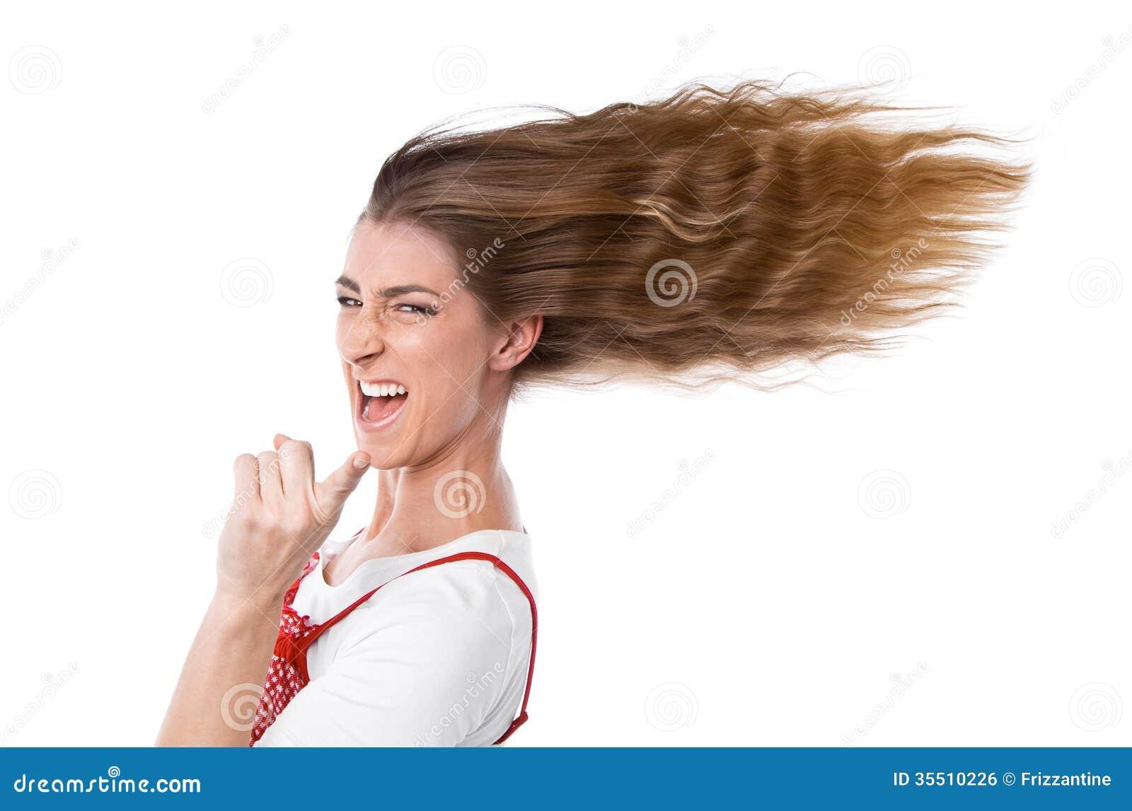 Donna con capelli in vento fotografia stock. Immagine di ...