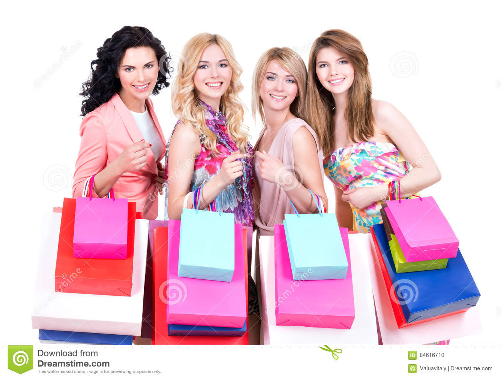 Donne sorridenti con i sacchetti della spesa multicolori
