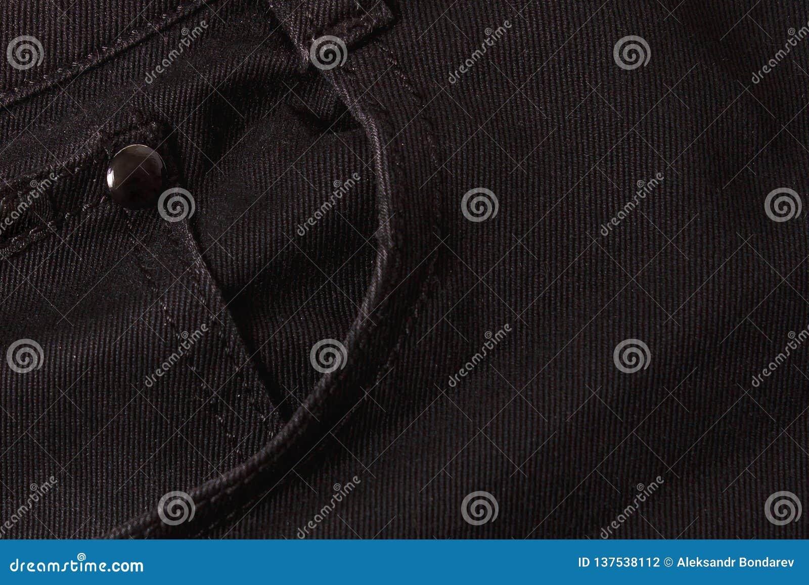Donnez au fond une consistance rugueuse des jeans et des poches noirs