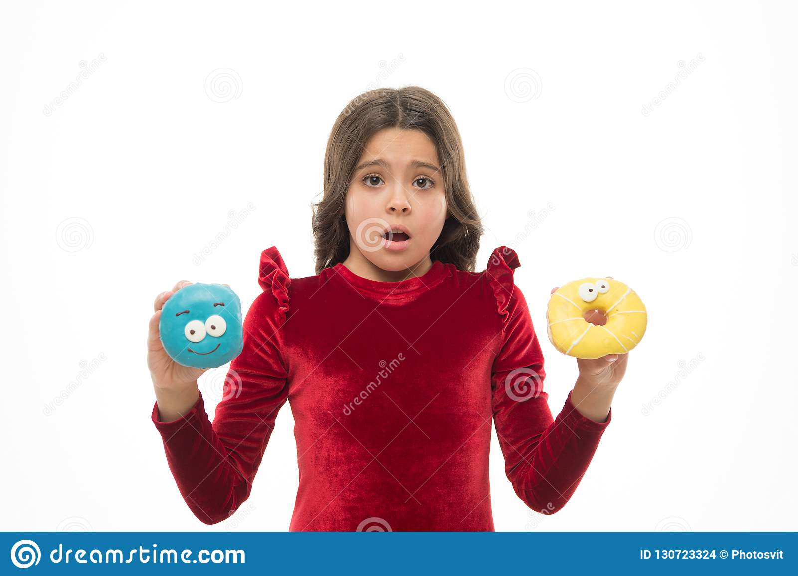 Dont know which to eat first. Small kid in doughnut bakery. Little child with funny donuts. Adorable small girl in