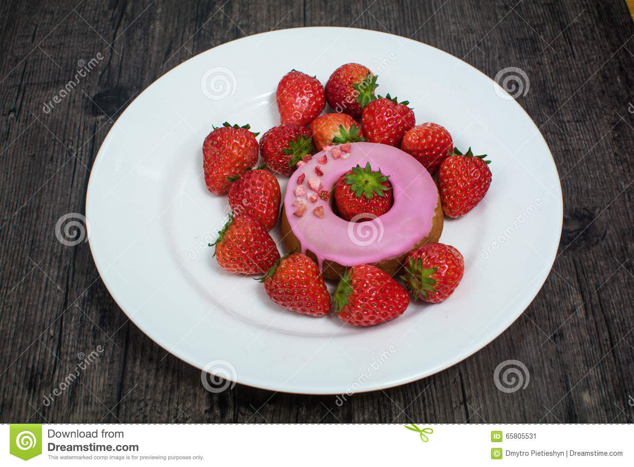 Donut and strawberry on the plate