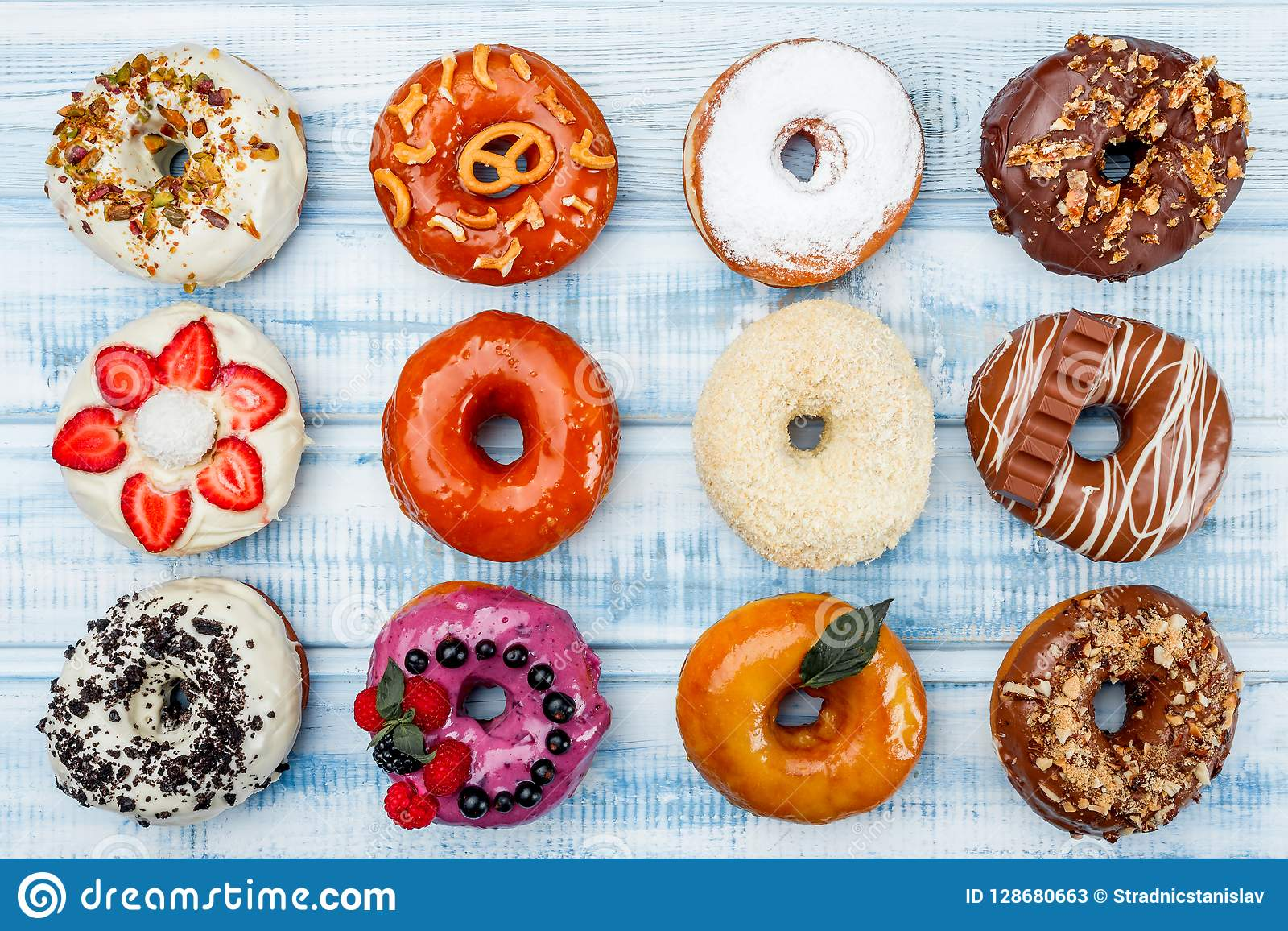 Donuts In assortment, on old wood background. Top view. Space for text