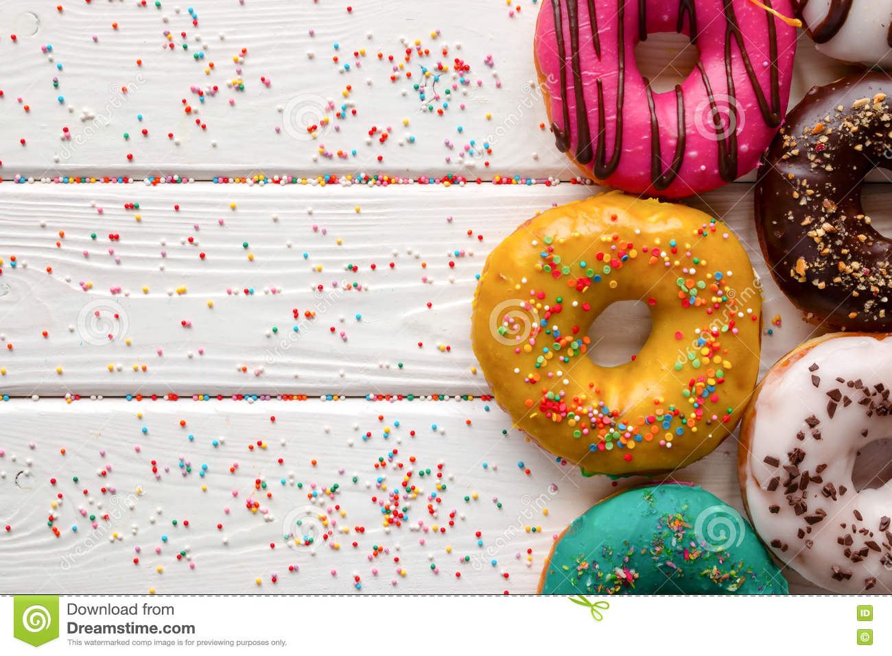 Donuts In Different Glazes On Wooden Background And Space ...